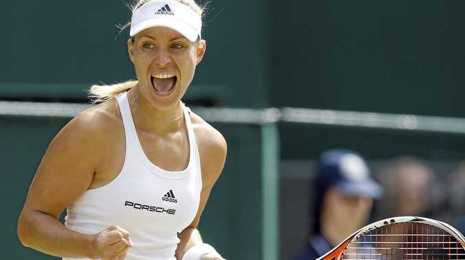 INTO DECIDER: Angelique Kerber of Germany celebrates a point against Venus Williams of the US during their women's singles match at Wimbledon.