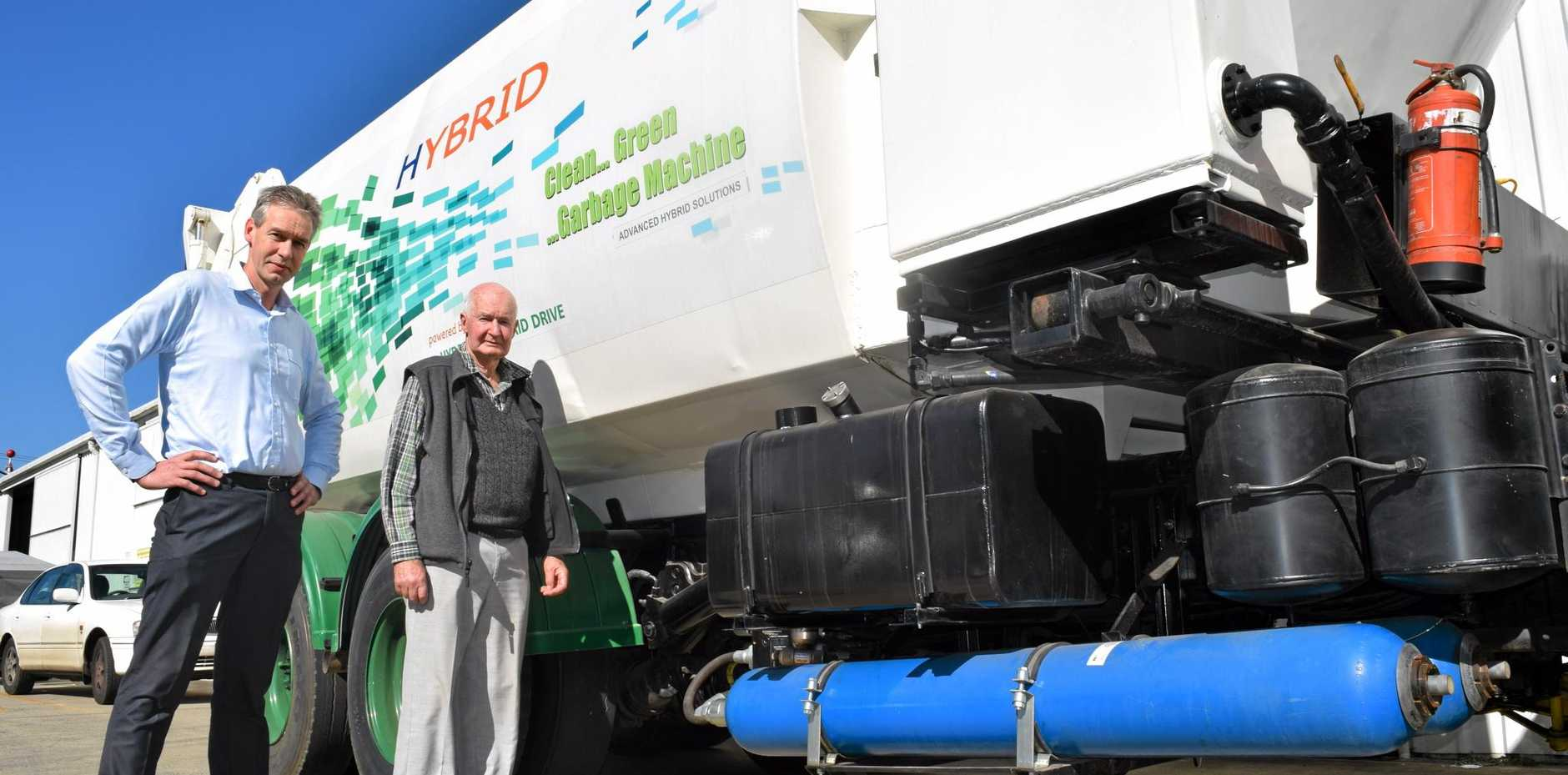 FUEL SAVING: Advanced Hybrid Solutions director Neil Hargreaves (right) with managing director of Adelaide-based Green Star Engineering Arie Overduin in front of a prototype hybrid system currently in testing.