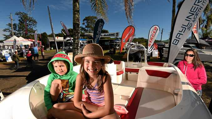 FUN AND SUN: Kameka, 7, and Declan, 5, Allen with their mum Juanita get a closer look at one of the speed boats on display at the Lismore 4WD Show.