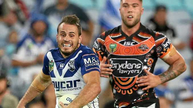 FULL FLIGHT: Bulldogs player Josh Reynolds runs with the ball during the round 10 NRL match against the Wests Tigers at ANZ Stadium in Sydney.