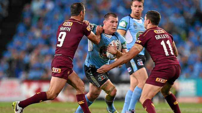 BLUES WARHORSE: Paul Gallen of NSW is tackled by Cameron Smith and Matthew Gillett of Queensland during State of Origin Game I.