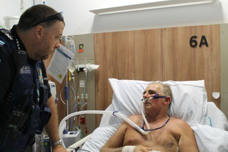 Mirani Senior Constable James Dolby visiting mate Graeme Ware in hospital. Snr Const Dolby recommended the Emergency Position Indicating Radio Beacon (EPIRB), which helped save Graeme's life after he was gored by a wild bull on June 6.