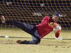 Matt Edgerton, West Wanderers stops this shot from Zachary Taylor, St Albans.