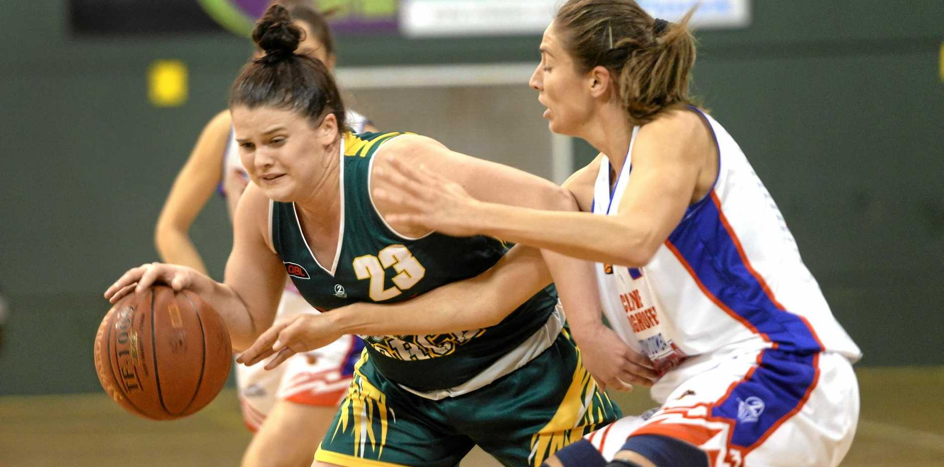 Ipswich Force basketballer Ashleigh Heal works hard to control play in Saturday night's state league win over Toowoomba.