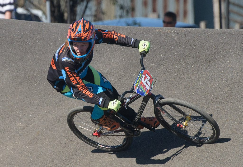Clarence Valley rider Stacey Brown rounds a corner in the 13-14 years crusier division at NSW BMX titles at South Grafton