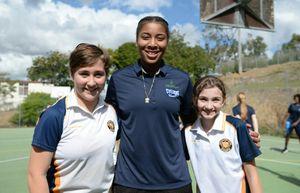 Abbey Leefenton and Tiarna Ceyhan with Cyclones player Chandrea Jones. Photo Allan Reinikka / The Morning Bulletin