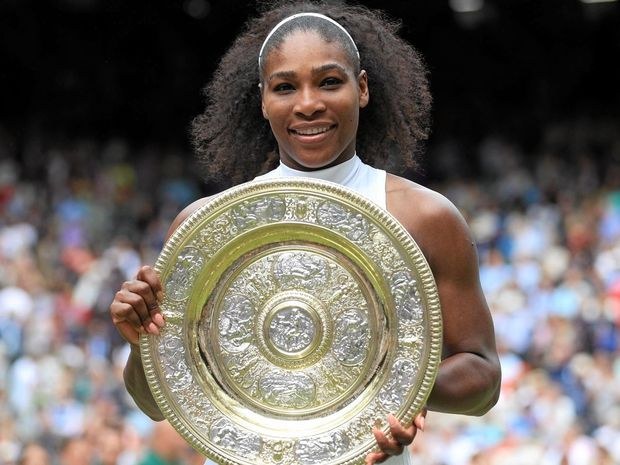 NO. 22: Serena Williams of the US with the Wimbledon championship trophy.