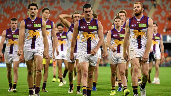 CONFIDENCE DOWN: Lions players are dejected as the leave the field following the Round 16 AFL match against the Gold Coast Suns.