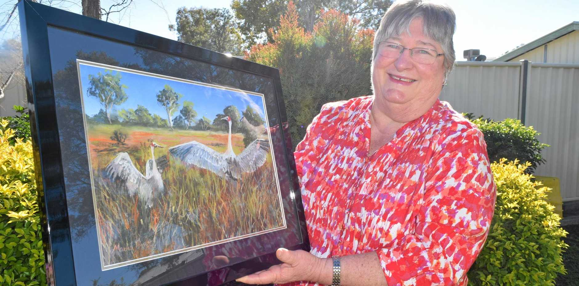JOY OF ART: Roma's Mavis Bunt will be displaying 33 of her favourite works of art on Sunday to help raise money for the Roma Hospital Auxiliary.