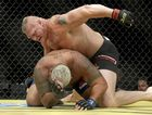 TOO GOOD: Brock Lesnar (top) hammers Mark Hunt during their heavyweight mixed martial arts bout at UFC 200 in Las Vegas.
