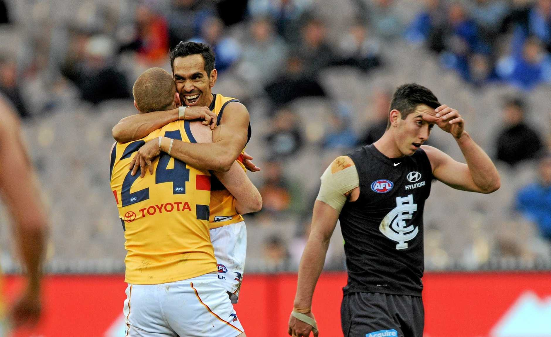 OLD BLUES: Sam Jacobs celebrates with Crows teammate Eddie Betts at the MCG yesterday.