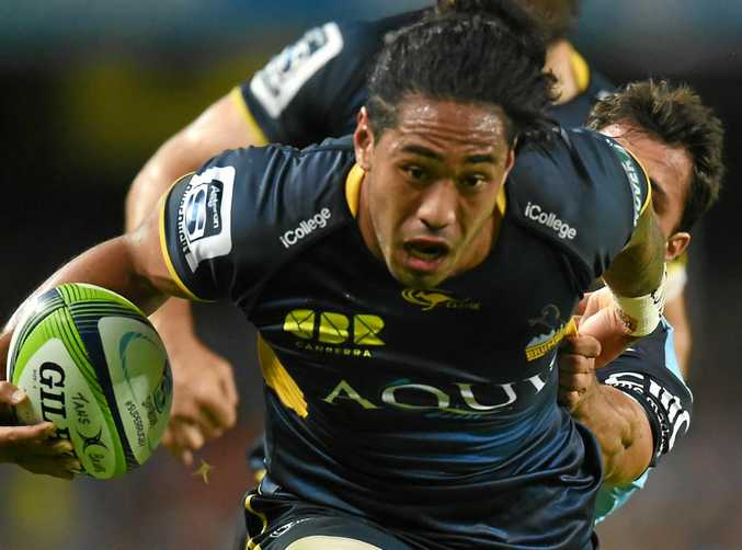 INJURY CURSE: Joe Tomane of the Brumbies charges up the field.