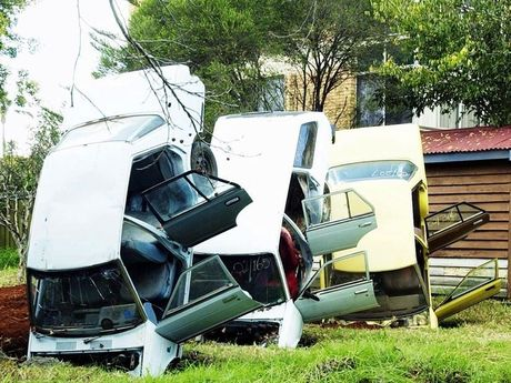 The Pig house in Godsall street. Terry Hendicott had a four-year battle with Toowoomba City Council. Cars upended in