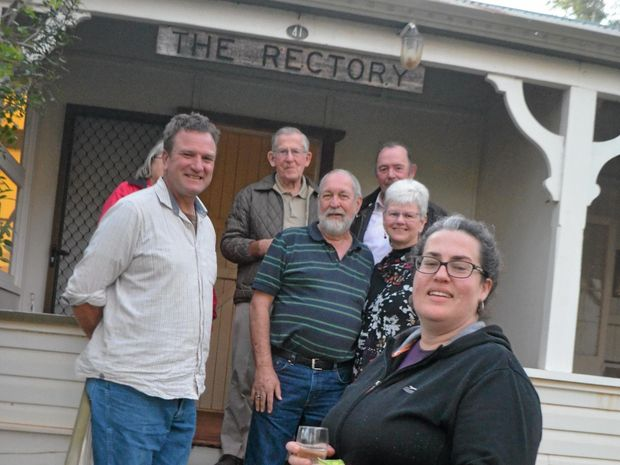 CRACK THE TON: Some of the local Anglican community met up to celebrate the rectory's 100th birthday.