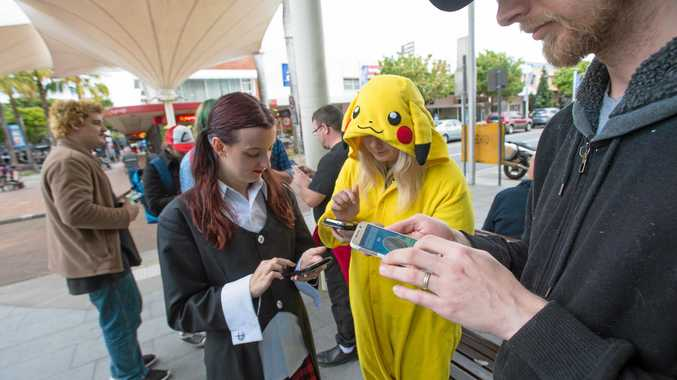 GAMERS: Pokemon trainers Courtney Aliotta, Sami Cassidy and Brandan Moffitt out and about playing Pokemon Go in City Square.