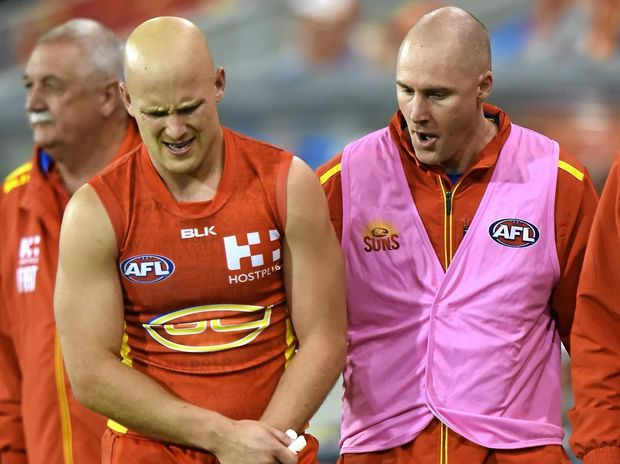 SEASON OVER: Suns player Gary Ablett is taken from the field after sustaining an injury in the fourth quarter against the Lions at Metricon Stadium.