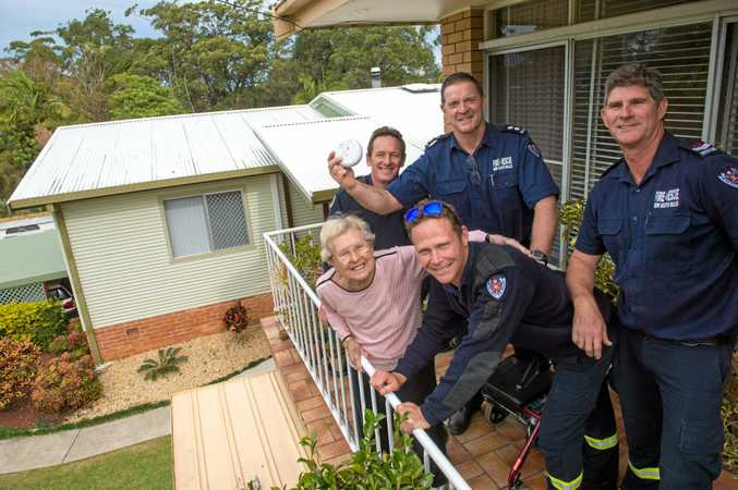 ON FIRE: Local firefighters Brad, Matt, Anthony and Tony assist Barbara Wallace with her smoke detectors.