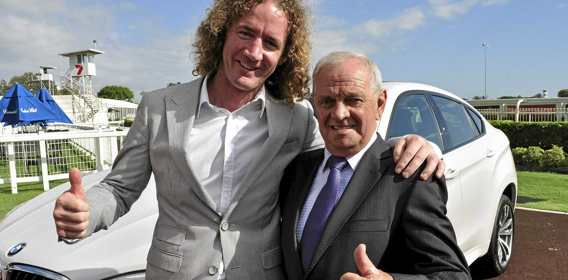 THUMBS UP: Into the Red trainer Kelso Wood (right) alongside former Grafton Cup winning trainer Ciaron Maher at Doomben Racecourse earlier this year.