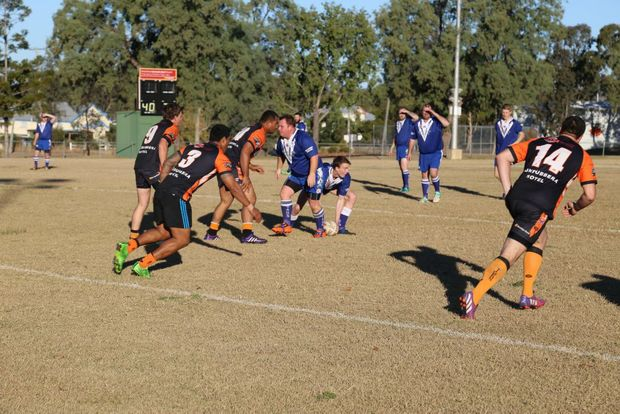 Nanango players pass the ball at the Mundubbera v Nanango game.