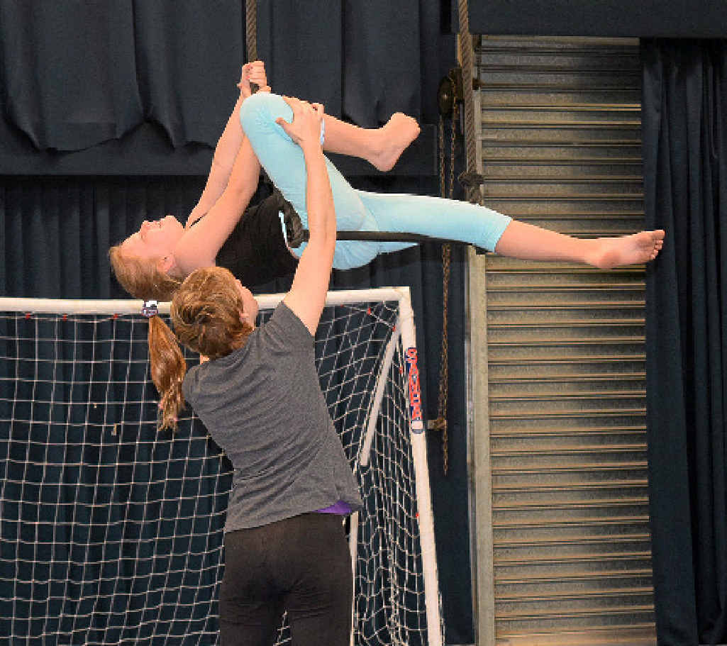 GET MOVING: Amelia McKay, 8, trying out the trapeze at the Sensory Circus.