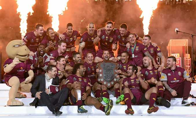 Queensland players celebrate following State of Origin Game III between the NSW Blues and Queensland Maroons at Suncorp Stadium in 2015. (AAP Image/Dave Hunt) NO ARCHIVING, EDITORIAL USE ONLY