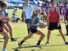 Lizzie Waters makes a run for Gympie U14 girls against Hervey Bay in the Queensland Touch Football 2016 Junior State Cup.