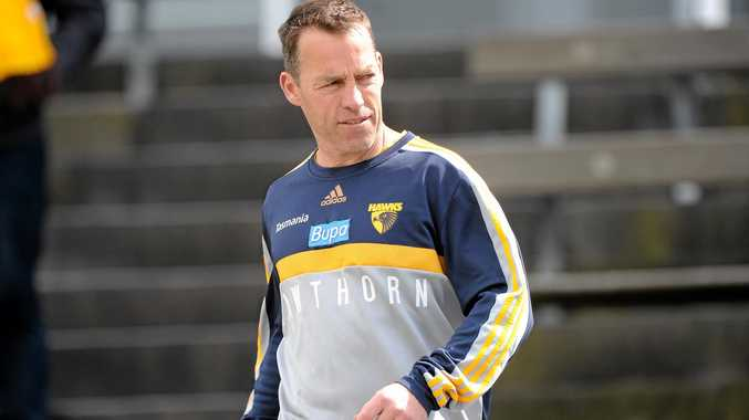 FEISTY MOOD: Hawthorn coach Alastair Clarkson joins his players as they train at Waverley Park in Melbourne.