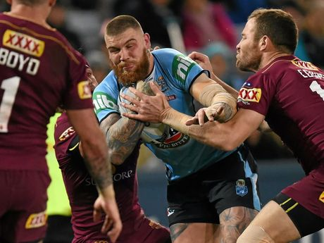 Josh Dugan of the Blues is tackled by Gavin Cooper of the Maroons during State of Origin Game 3 between the NSW Blues and Queensland Maroons, at ANZ Stadium in Sydney on Wednesday, July 13, 2016. (AAP Image/Dean Lewins) NO ARCHIVING, EDITORIAL USE ONLY