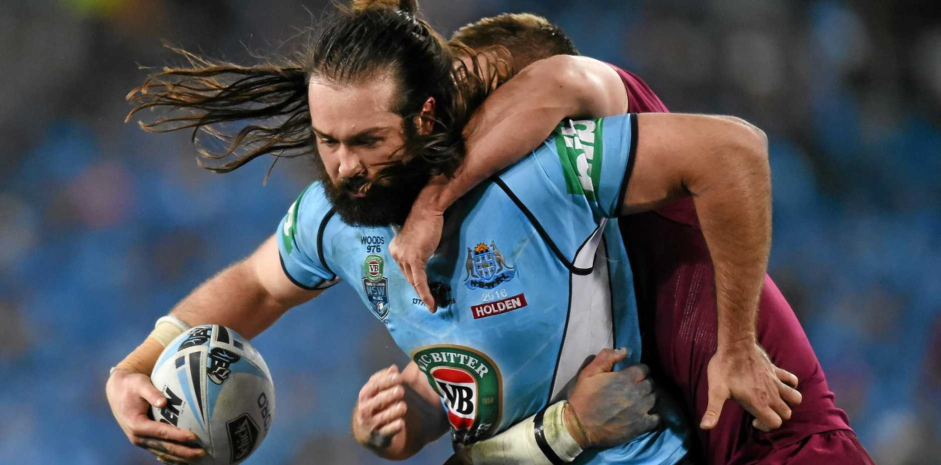 POWER GAME: Blues prop Aaron Woods tries to push through the Maroons defence during last night's Origin III at ANZ Stadium.