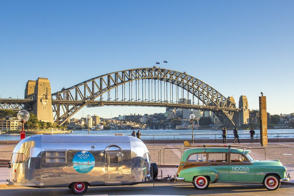 Vintage surf vehicles at Sydney in July promoting Noosa to chilly southerners.