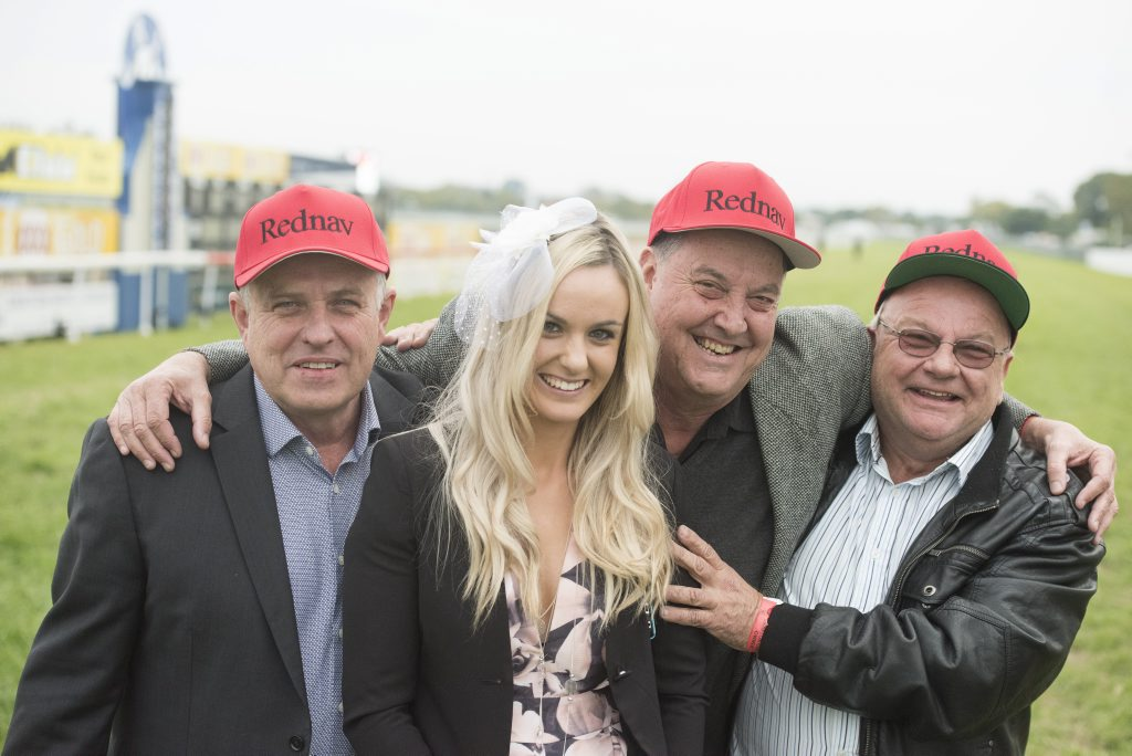 With their specially made hats, connections of the 2016 Grafton Cup winner Rednav pose with trainer Sally Taylor.