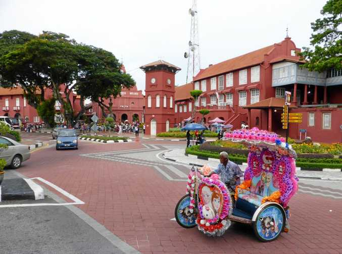 The central town square in Malacca dates back to the 16th century. The modern mode of transport through the area is by brightly adorned rickshaws which pump out loud music.