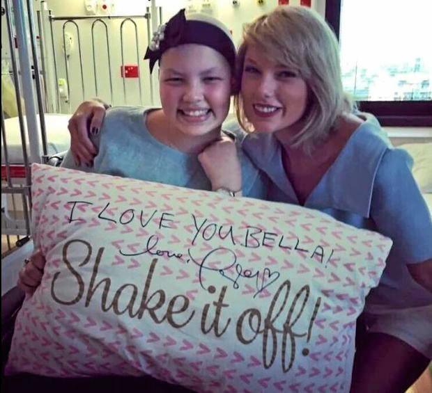 PRICELESS ENCOUNTER: Bella Harry meets American superstar Taylor Swift at Brisbane's Lady Cilento Children's Hospital.