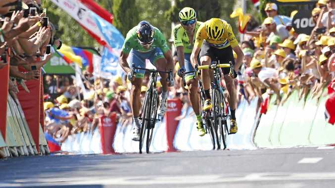 SPRINT FINISH: Stage winner Peter Sagan of Slovakia, wearing the best sprinter's green jersey, and Britain's Chris Froome, wearing the overall leader's yellow jersey, sprint towards the finish line of the 11th stage of the Tour de France over 162.5km from Carcassonne to Montpellier.