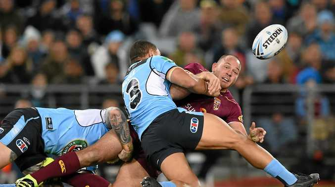 UNDER PRESSURE: Matt Scott of the Maroons offloads the ball as he is tackled by Michael Jennings and Tyson Frizell during State of Origin game three.