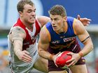 TOUGH SEASON: Dayne Zorko of the Lions tries to hold off Tom Mitchell of the Swans.
