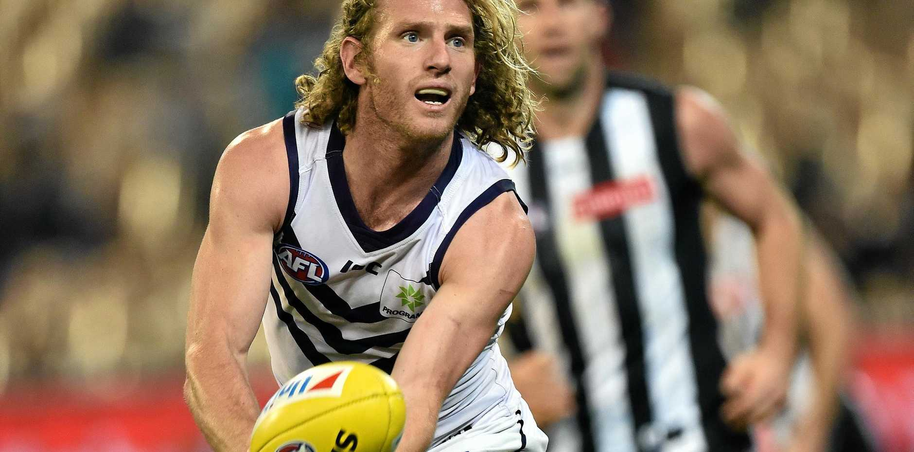 DANGEROUS DOCKER: David Mundy of Fremantle is under an injury cloud for tonight's clash with the Cats.