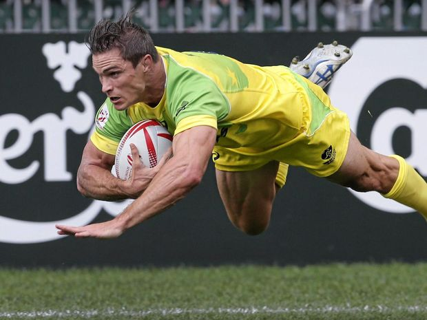 GREEN AND GOLD: Australia's Ed Jenkins gets away from Portugal's Pedro Leal to score a try during the Hong Kong Sevens rugby tournament in April.