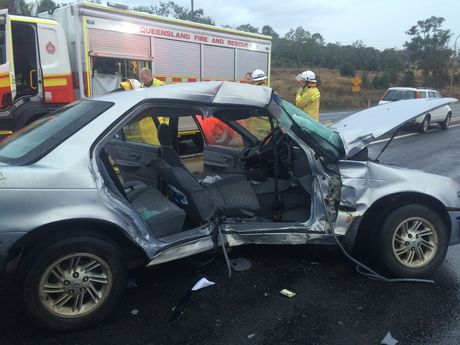 A man is critical after a horror crash involving a truck and two cars near Toowoomba on the Warrego Hwy.