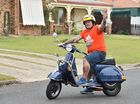 "Cheap transport - Paul Cowey with his 2003 Vespa Piaggio called ""Betsy"" which costs him around $5 to fill up."