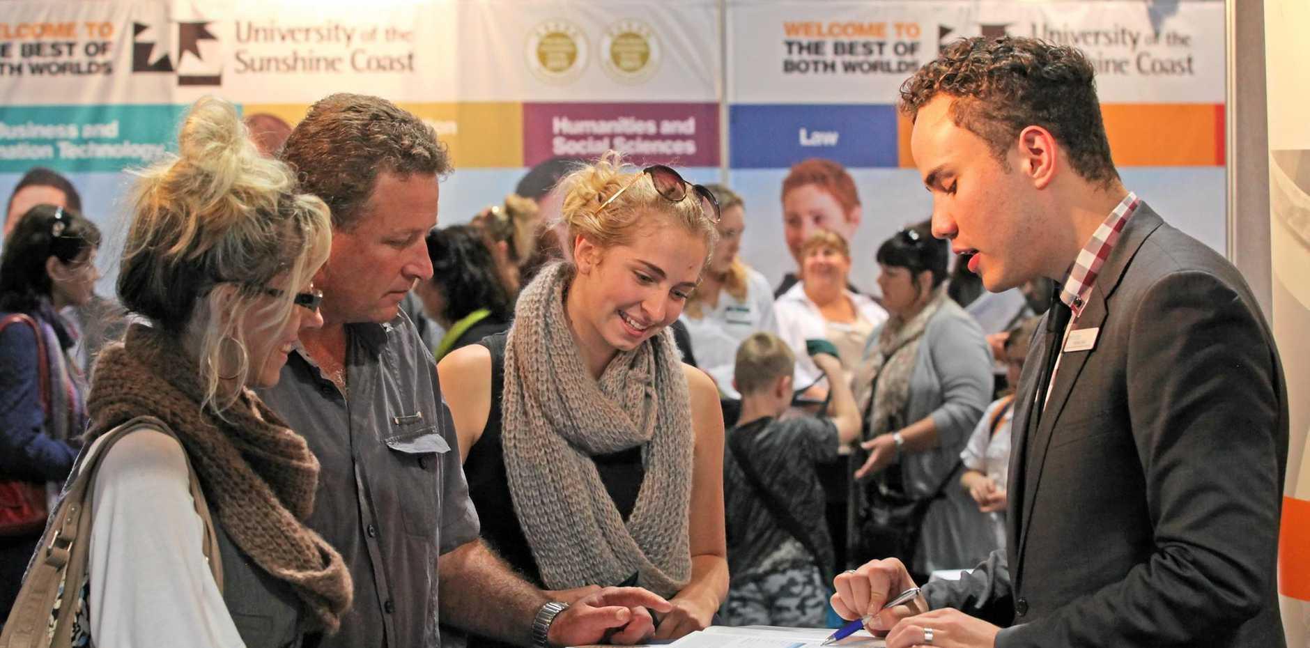 JOBS HUNT: Angela, Glenn and Alysha Haack, of Cooroy, chat with Joshua Suli, of Blue Mountains International Hotel Management Australia, at last year's Sunshine Coast Daily Careers Expo.