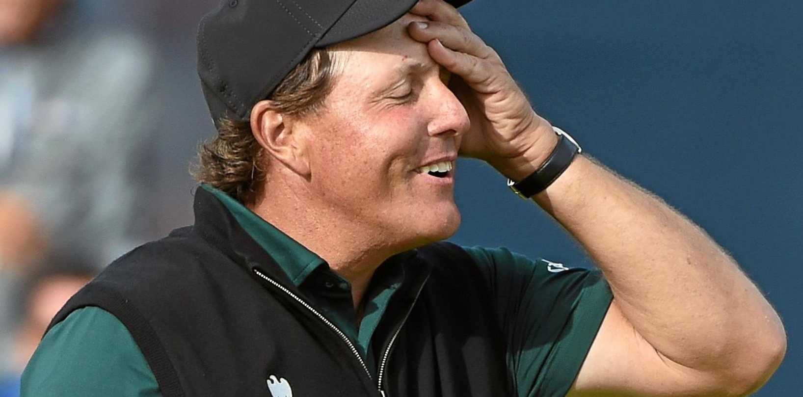 SO CLOSE: Phil Mickelson of the US finishes the 18th hole on the first day of the British Open at Royal Troon.