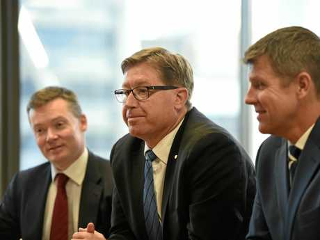 NSW Premier Mike Baird (right) and Deputy Premier Troy Grant (centre) meet with members of the greyhound industry in Sydney, Thursday, July 14, 2016. (AAP Image/Dean Lewins) NO ARCHIVING
