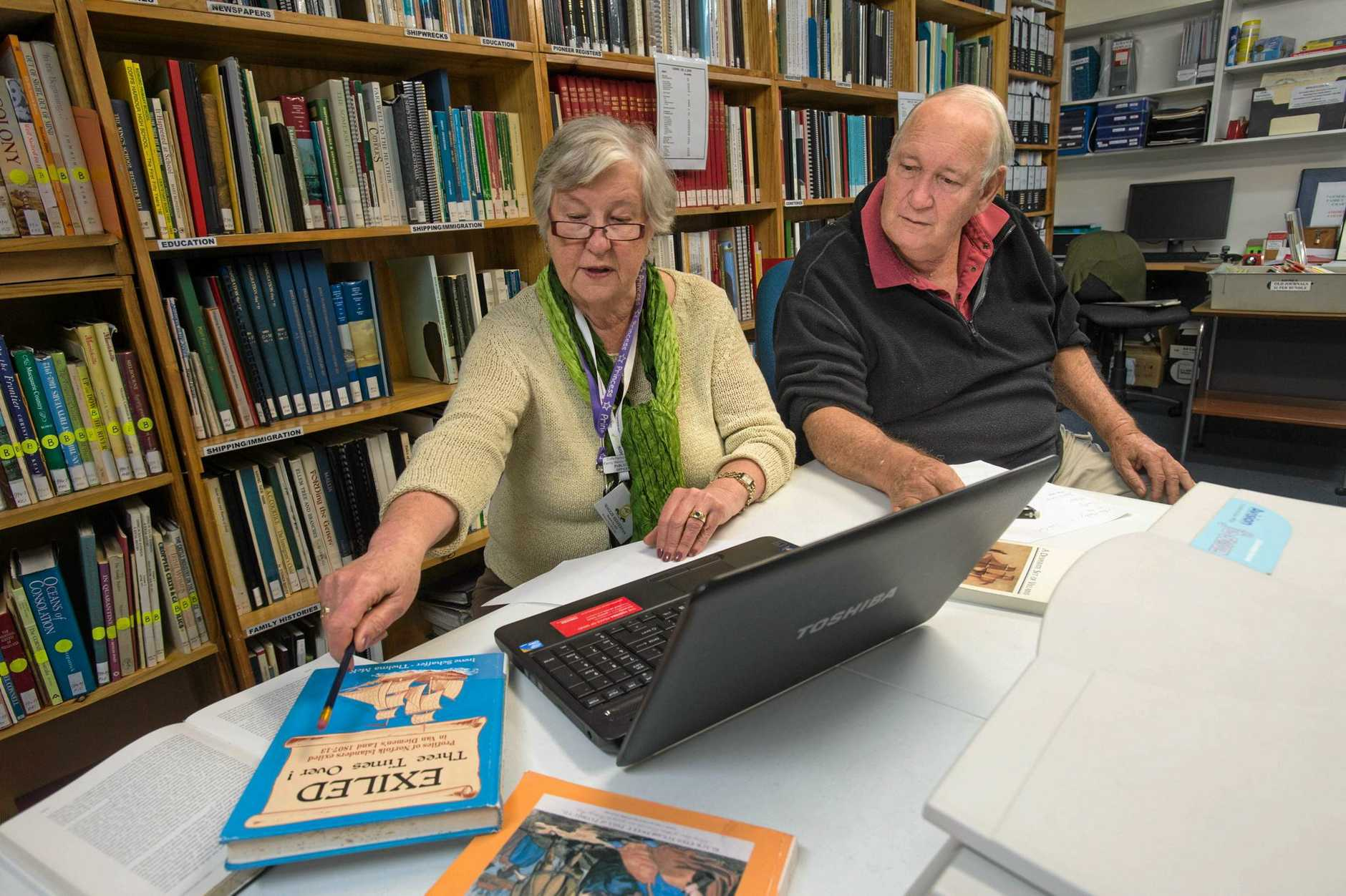 LOOKING BACK: Family history researchers Maggie Heffernan and Bill Buckler busy cross referencing.