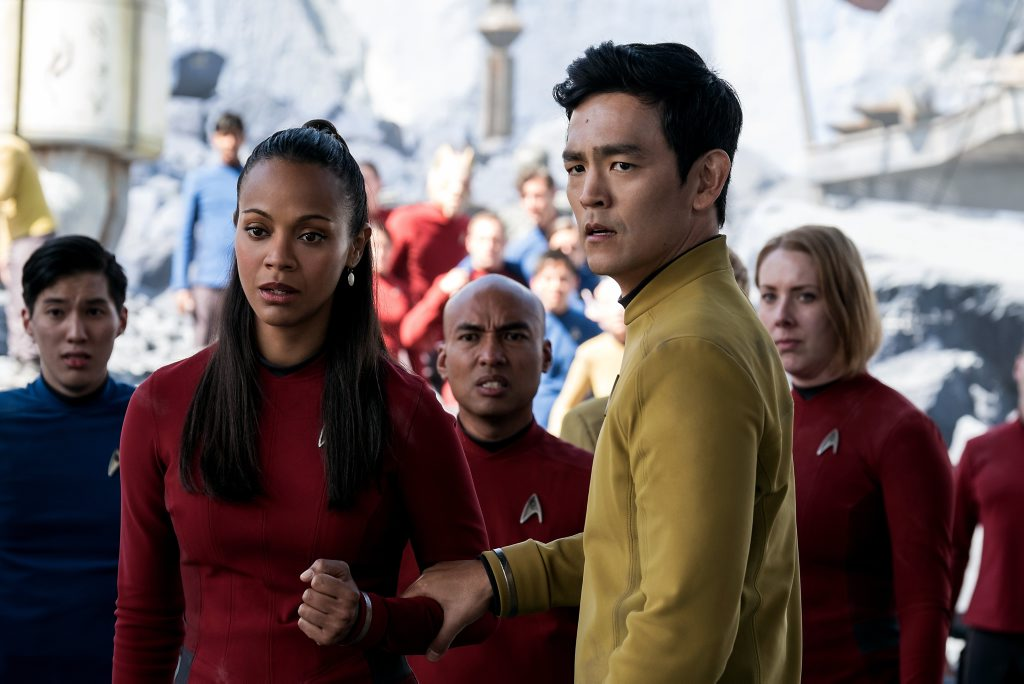 Zoe Saldana and John Cho in a scene from the movie Star Trek Beyond.