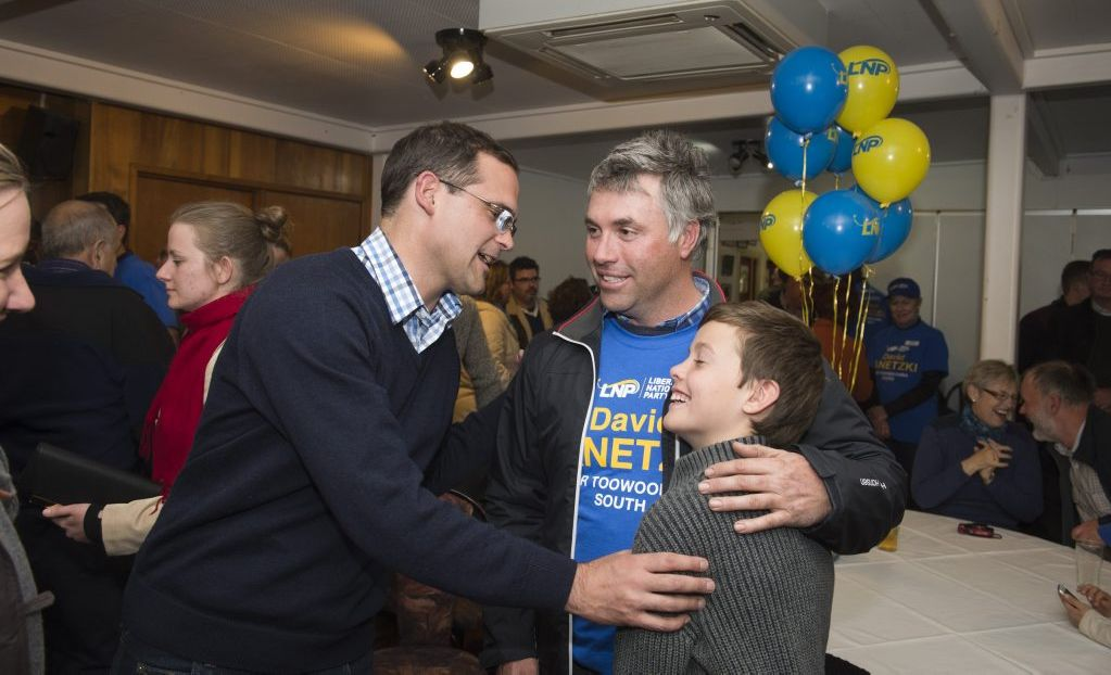 LNP candidate David Janetzki thanks Jeremy Wise and son Matty Wise for their support as LNP party members gather post South Toowoomba by-election at Gold Park.