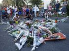 People pay tribute to the victims at the site of a deadly truck attack on the famed Promenade des Anglais in Nice, southern France, Saturday, July 16, 2016.