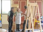 Artist John Glese shows his students Caz Scott (left) and Kerrie Thomspon at his workshop in Brooms Head on Saturday.
