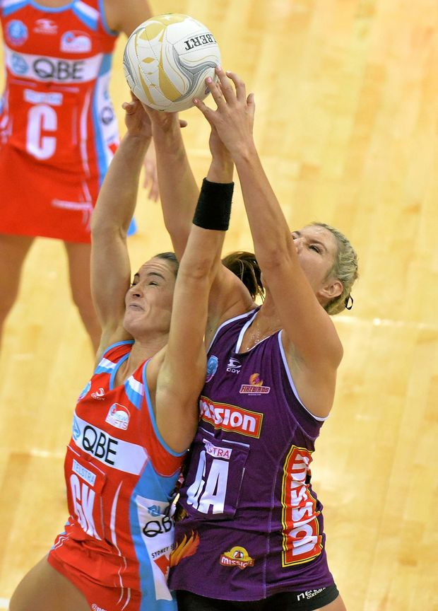 MY BALL! Gretel Tippett of the Firebirds and Sharni Layton fight for the ball.