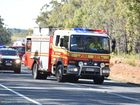 Emergency services arrive at a rollover near Hervey Bay.